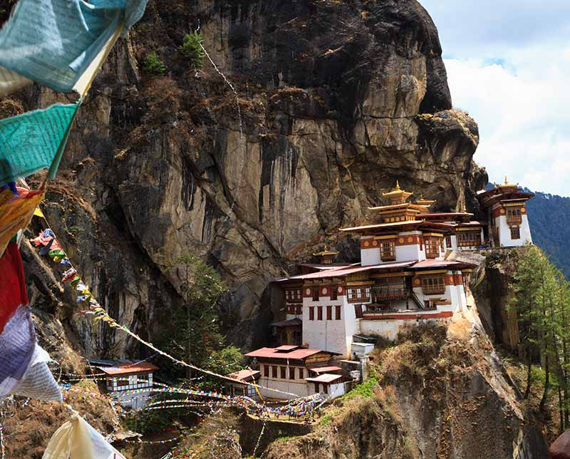 Cliff side homes. Bhutan, Asia