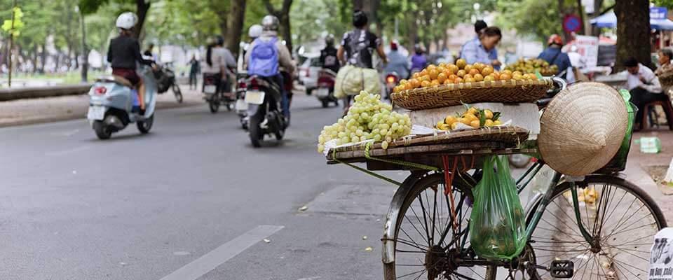 Biking with fruit. Vietnam, Asia.
