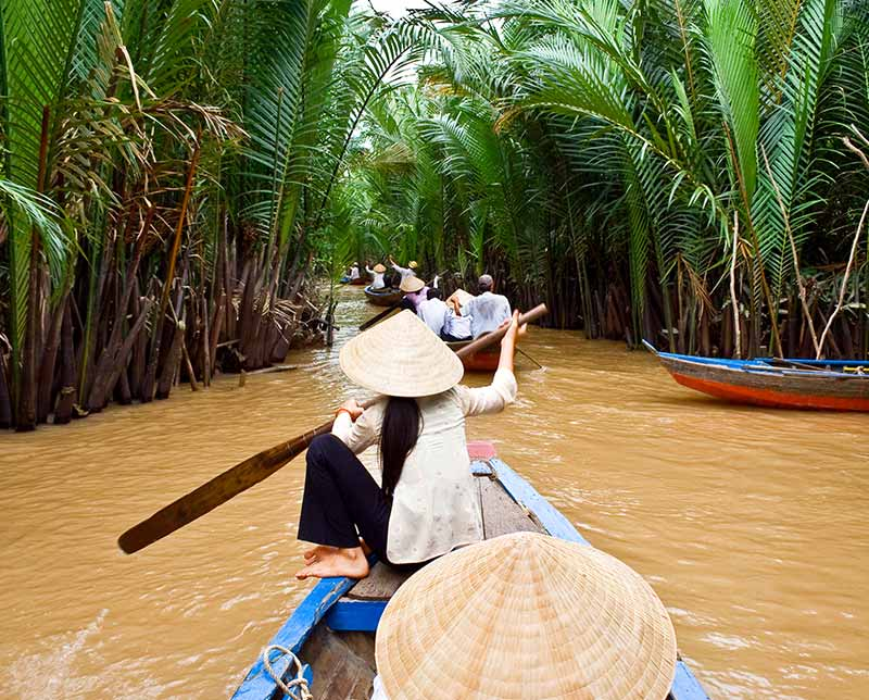 Paddling in the river. Vietnam, Asia.