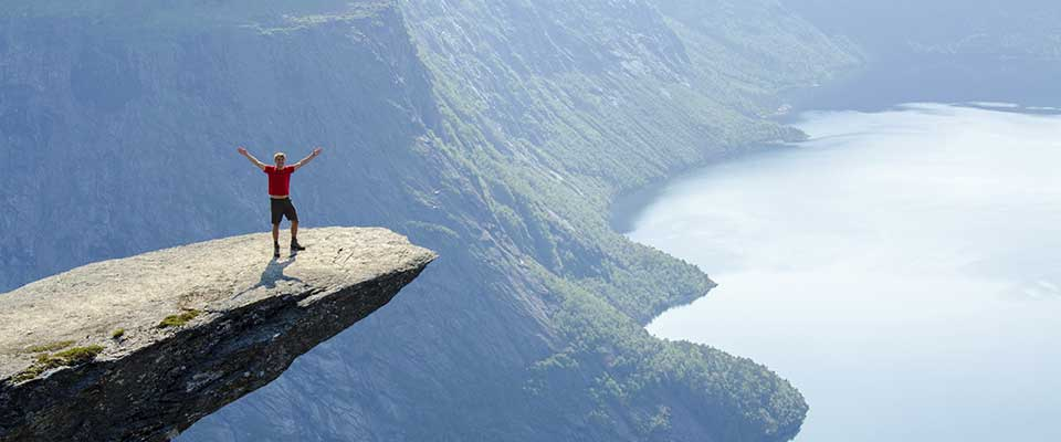 Guy on the edge of a cliff. Norway.