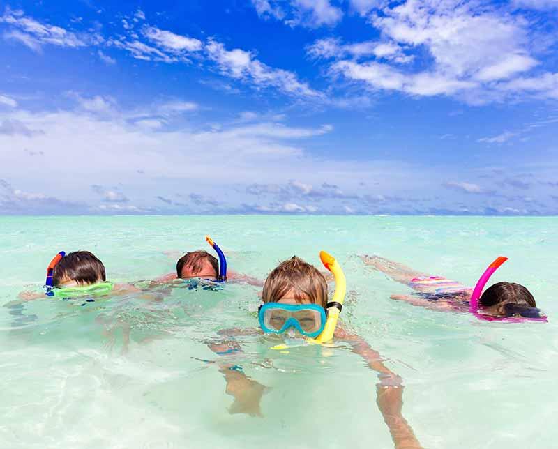 Family snorkeling. Mexico.