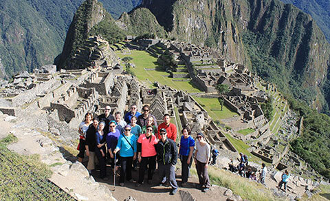 A group of people at Machu Pichu. South America.