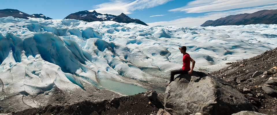 Guy admiring ice glaciers. Argentina and Chile.