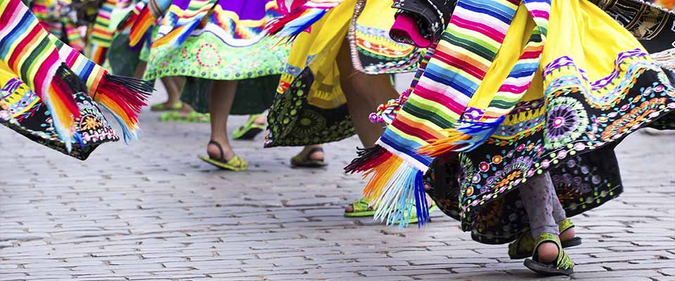 Women in skirts dancing. Peru.