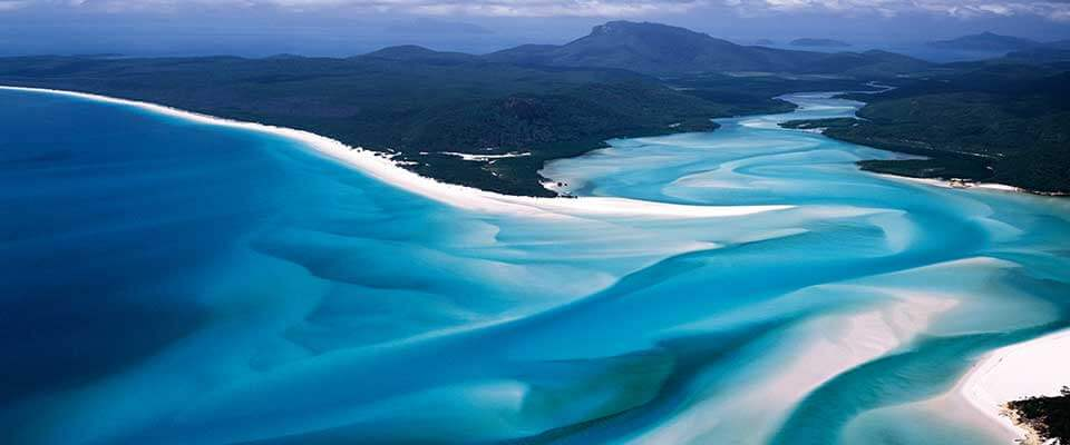 White beach sands and blue water. Australia.