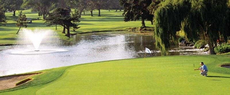 Golf course, golfer putting. San Diego, California.