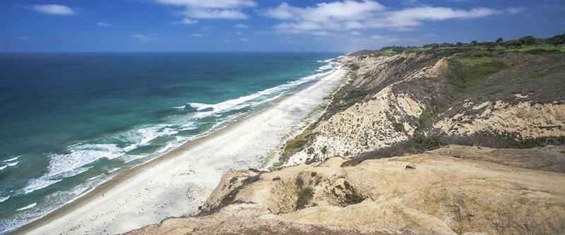 Sandy beach and rocky cliffs. San Diego, California.