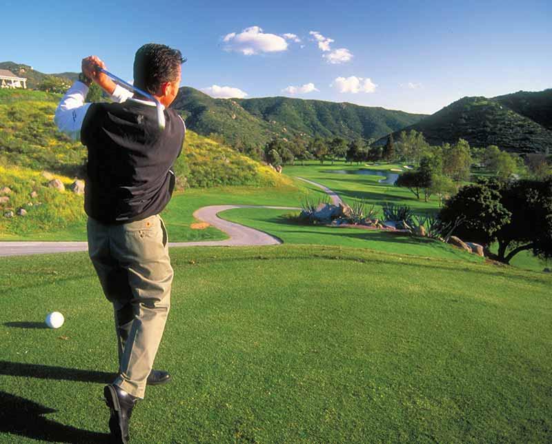 Sycuan Resort, golfer taking a swing. San Diego, California.