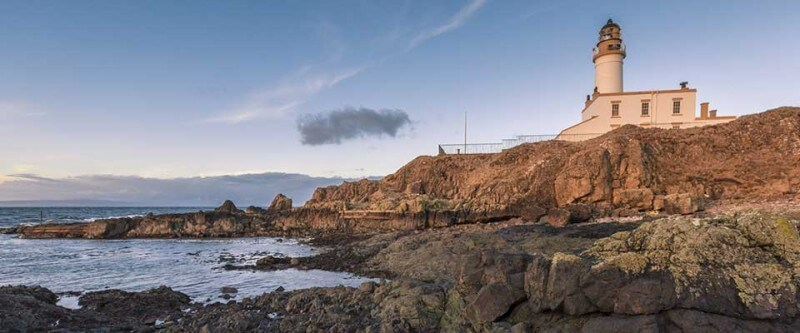 Lighthouse on the rocks. Glasgow and Ayrshire, Scotland.