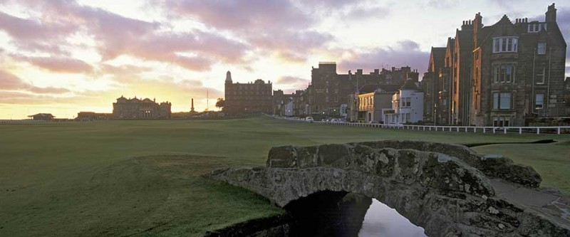 Golf course with a creek and bridge. Old Course Tee Times, Scotland.