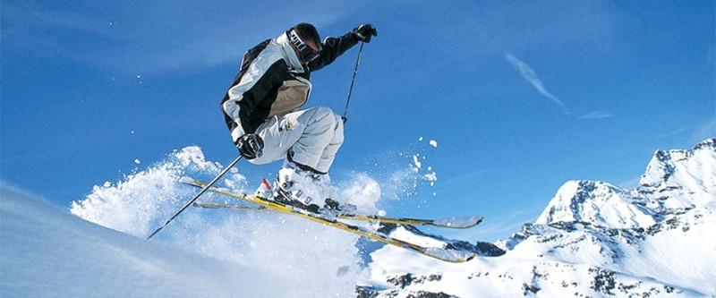 Skiier catching air. Innsbruck, Austria.