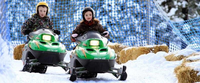 Kids snowmobiling. Silver Star, BC.