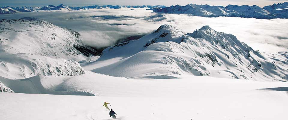 Skiing above the clouds in the mountains. Whistler, BC.