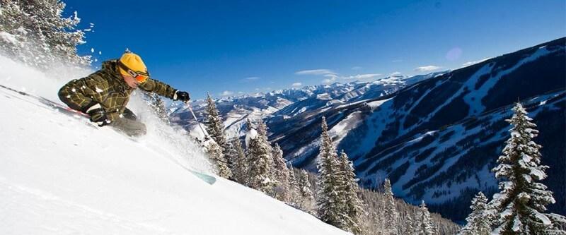 Skiier making a sharp turn on the hill. Beaver Creek, Colorado.