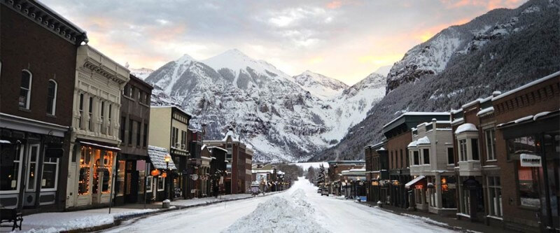 Standing in the middle of a small town street with mountain view. Telluride, Colorado.