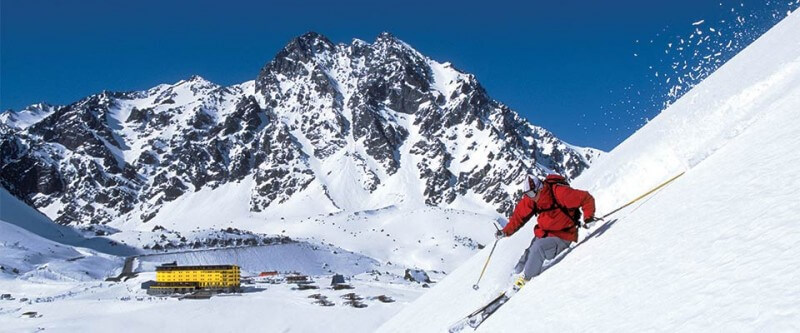 Skiing down a steep slope. Portillo, Chile.