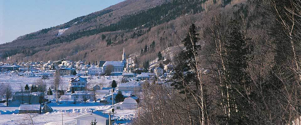 Ski village bordering the forest and mountains. Le Massif, Quebec.