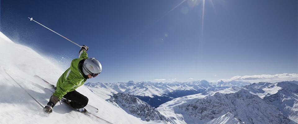 Skiier making a sharp turn on the hill. Davos, Switzerland.