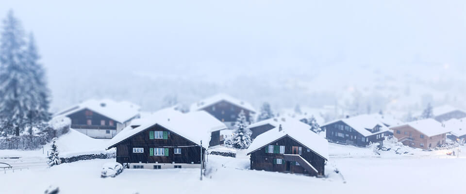 Tilt shift picture of cottages in winter. Grindelwald, Switzerland.