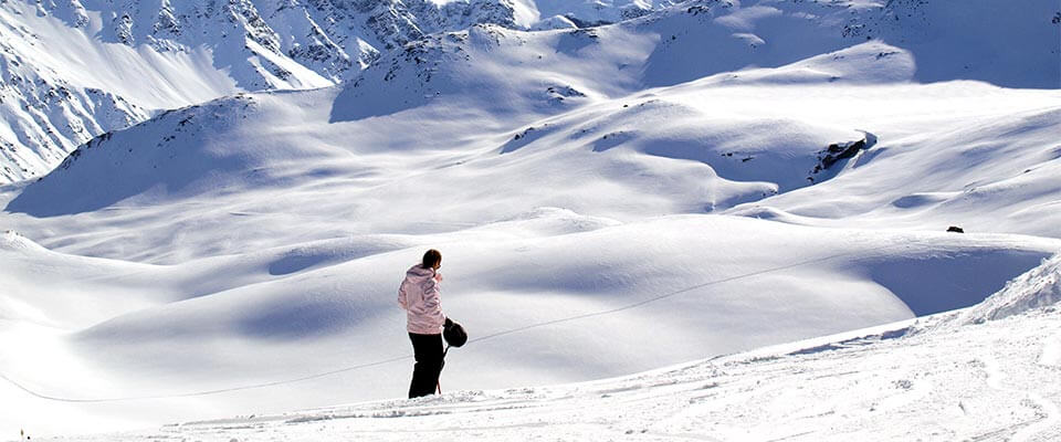 Person looking down at the ski trail. Grindelwald, Switzerland.