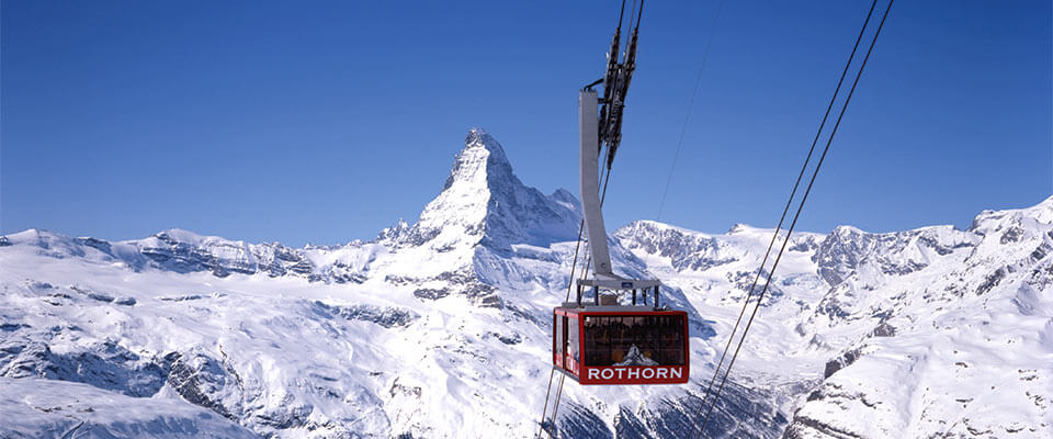 Ski gondola with rocky mountains. Zermatt, Switzerland.