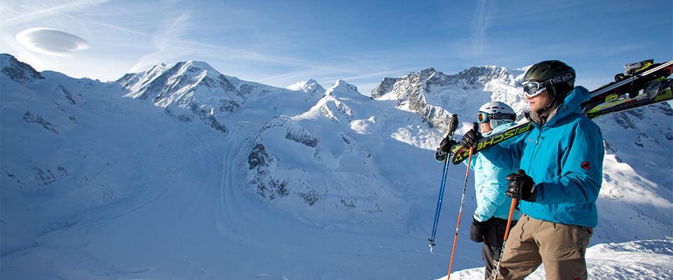 Skiiers walking to their trail on the mountain top. Zermatt, Switzerland.