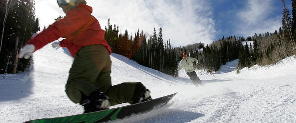 Close-up of a snowboarder in action. Park City, Utah.