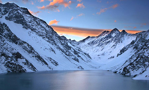 Beautiful sunset over the snowy mountains. Chile.