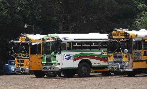 Old American School buses are now the normal public bus in El Salvador